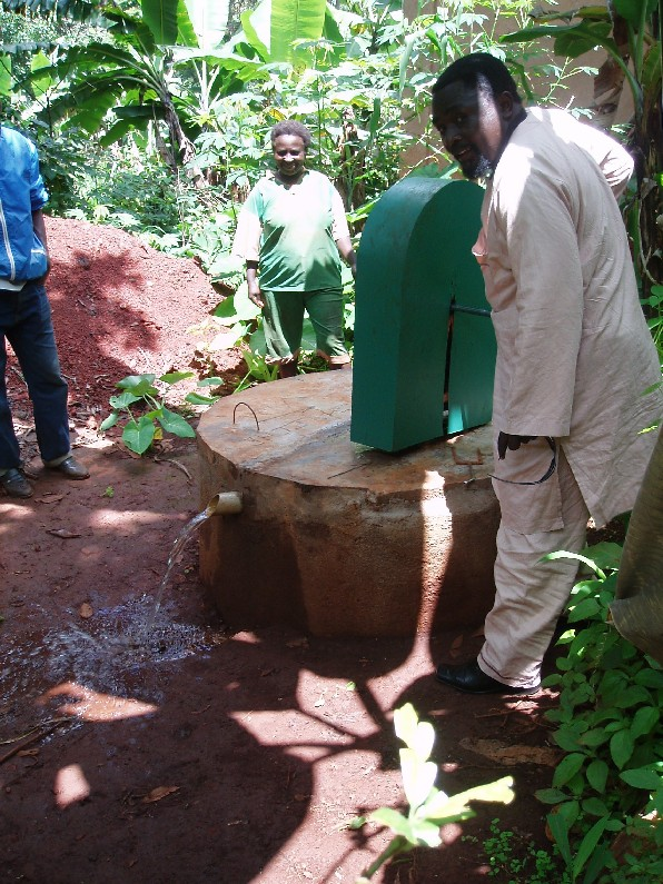 Visiting a new well, in the village of Bambe